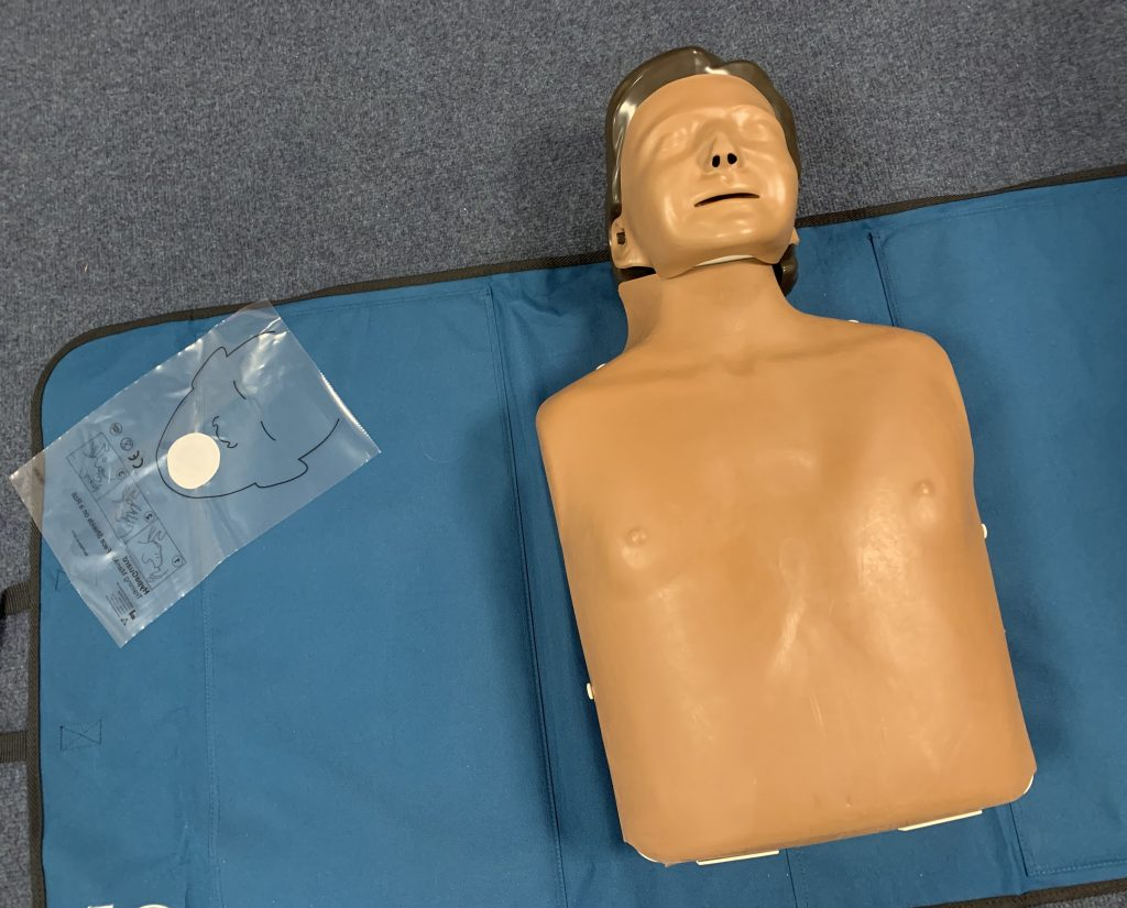 One of our mannequins set up with a face shield provided to further prevent contamination. This is one of many precautions to ensure safety during our First Aid Training courses.